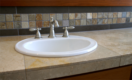 The finish on the faucet matches all the other plumbing and light fixtures in the bath.
