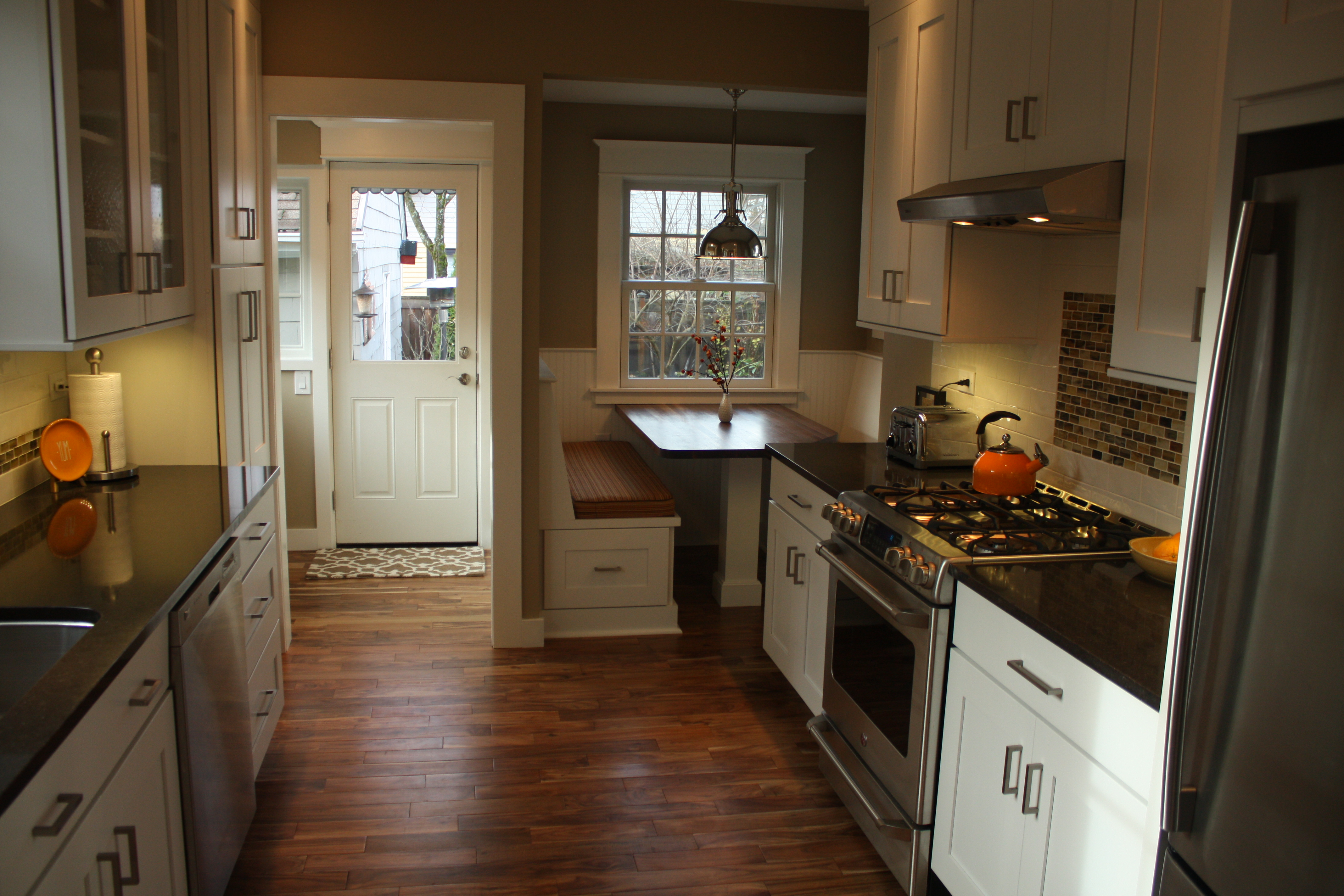 beautiful hardwood floors give this kitchen a rich warm feeling after replacing the door and windows the trim was reproduced in detail to match the rest - M Kitchen