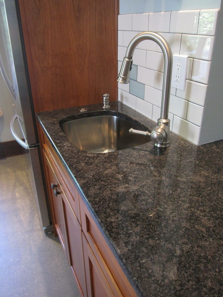 A secondary prep sink will improve the kitchen functionality, particularly for a larger family.